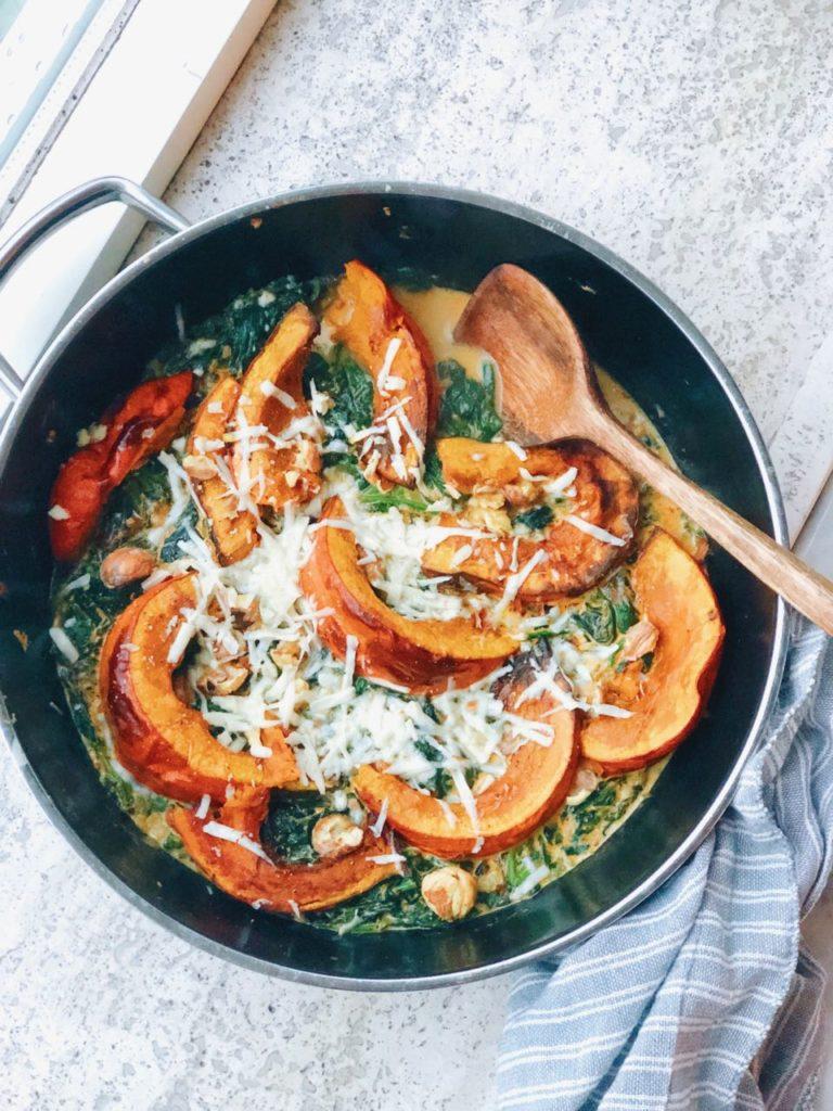 Kastanjes met pompoen en romige spinazie uit de oven